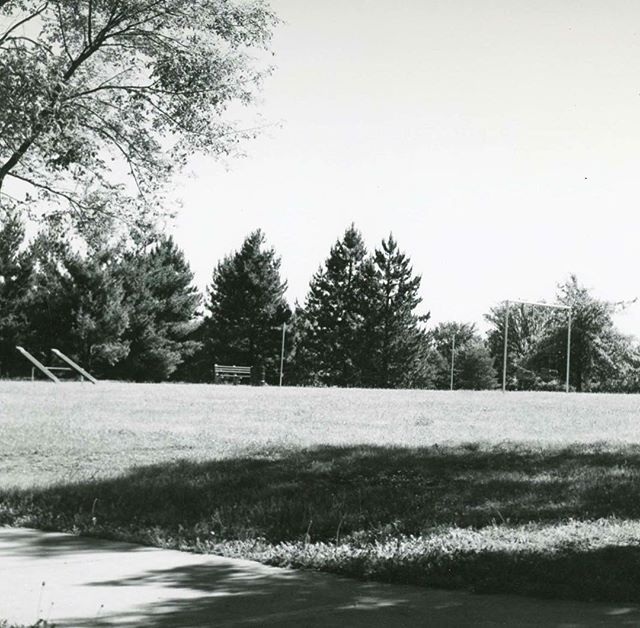 """{Throwback Thursday} HOLMES PARK circa 1950In 1943 two proposals were made to establish a park and playground in what was then the southwest part of the city.  One was made by Dr. Hayes Richardson, Director of the Welfare Department, for the use of empty ground between 67th and 70th Streets, Holmes and Campbell.  The other was made by architect for the Park Board S. Herbert Hare for property from 65th to 67th, Rockhill Road to Troost. In October 1943, the Park Board recommended that the property at 69th and Holmes be acquired as a """"playfield"""". The Board voted to condemn property for it in August 1944.  Known as """"69th Street Park"""" and """"69th and Holmes Park"""" the name was changed to Holmes Park in 1970, although it had been unofficially called that for some time.The park/playfield at 69th and Holmes was to be the first of four playfield areas the southwest part of the City.  Of the locations suggested in 1943 only this one and one near the water tower at 75th and Holmes (now Tower Park) were constructed.Holmes Park is a popular and well-used park with one baseball diamond, a playground, and open space. A roller hockey rink was constructed in 1999 where there had previously been tennis courts.  There have been recent improvements to the roller hockey area with more planned. A Boy Scout fire ring is located in the northeast corner of the park.  It is called the Burr Oak Council Ring and is used for Boy Scout ceremonies. #KCParks125 #FromTheArchives #TBT #ThrowbackThursday"""
