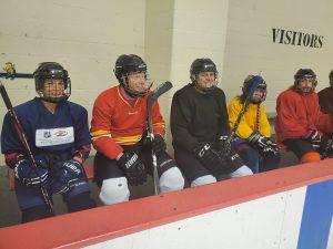 individuals in hockey gear