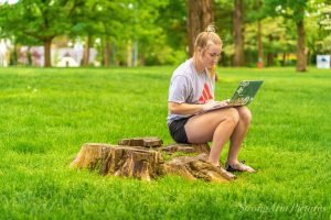 Girl in the park on computer