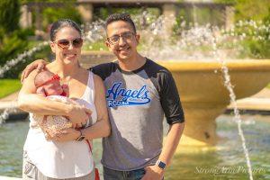 family next to the fountain