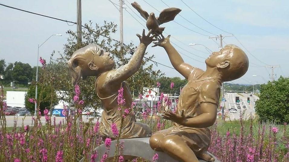 Kids freeing bird statue