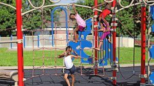 Kids climbing ropes at the park