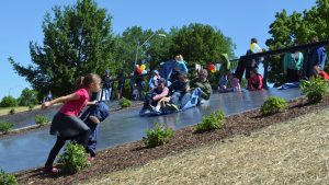 Individuals having fun sliding