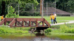 People walking on the bridge in Lakewood Green