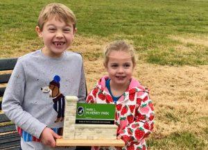 Kids holding a model of Mark L. McHenry Park