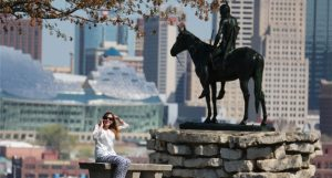 Girl posing infront of sculpture in Kansas City