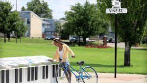 Girl Riding a bike on 12thj and 1600 W Vine st Kansas City