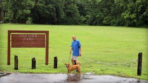 Man Walking Dog in Prather Park