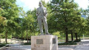 Ilus Winfield Davis statue infront of a building