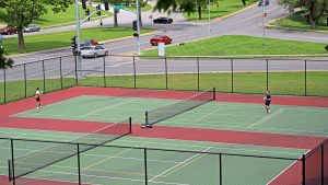 Kids playing tennis in the tennis court