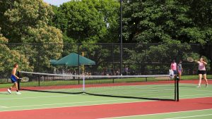 Playing tennis at loose park