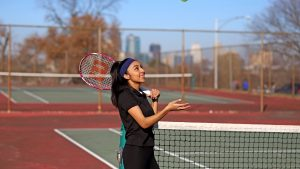 Girl playing tennis in the tennis court