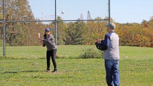 Adults playing baseball