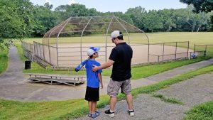 Boy with baseball gear