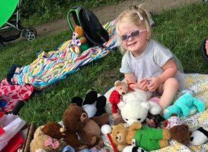 Girl playing with Teddy Bears