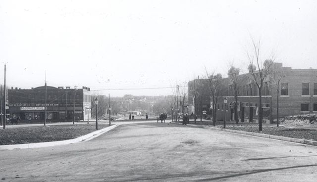{Throwback Thursday} This 1911 photograph taken by Kansas City photographer E. J. Davison is looking south on Broadway from High Street, now 40th Terrace, toward Westport Road. The buildings you see should be fairly recognizable to those who know Westport. The building on the left where poor Emerich Dry Goods is having a bankruptcy sale is the now former Bank of America building. The building on the right is still there. #TBT #throwbackthursday #kcparks #KCParks125