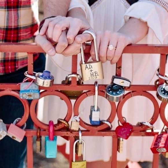 "KC's love locks tradition began five years and 3500+ locks ago on the Old Red Bridge! Celebrate your commitment by ""locking your love"" to the Old Red Bridge in Minor Park this Valentine's Day season. #RedBridgeLoveLocks #SouthKC #FiveYearsOfLoveLocks #KCParks #LoveLocks #RenewTheBlue ️"