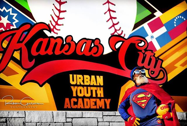 We love this picture of #KCSuperman in front of the Urban Youth Academy mural in #KCParks Parade Park. Thank you @rubengusmanphotography!