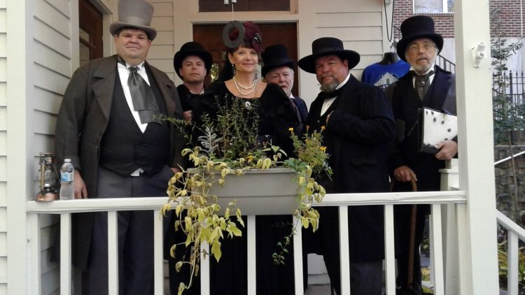 Individuals dressed in Black with Magician Hats