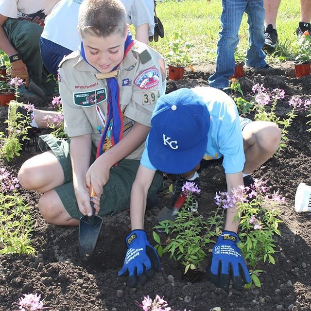 Get ready for #DigDay! HOA Boy Scouts of America and KC Parks employees will plant more than 100 of the city's community flower beds on May 12.
