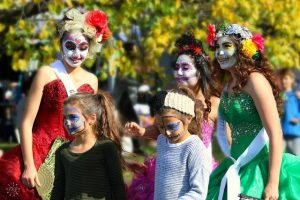 Individuals dressed up for day of dead