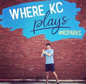 Teenager infront of KC Parks wall art
