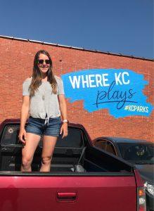 Girl infront of KC Parks wall art