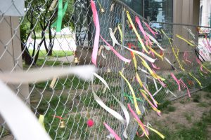 Ribbons and bells on Stell fence