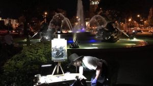 Painter painting infront of fountains