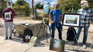 Individuals Displaying Canvas Paintings